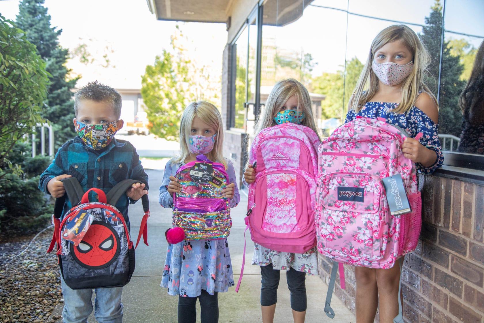 Backpack day children holding backpacks
