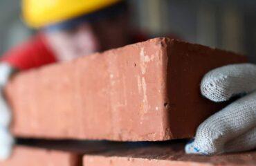 construction worker laying bricks
