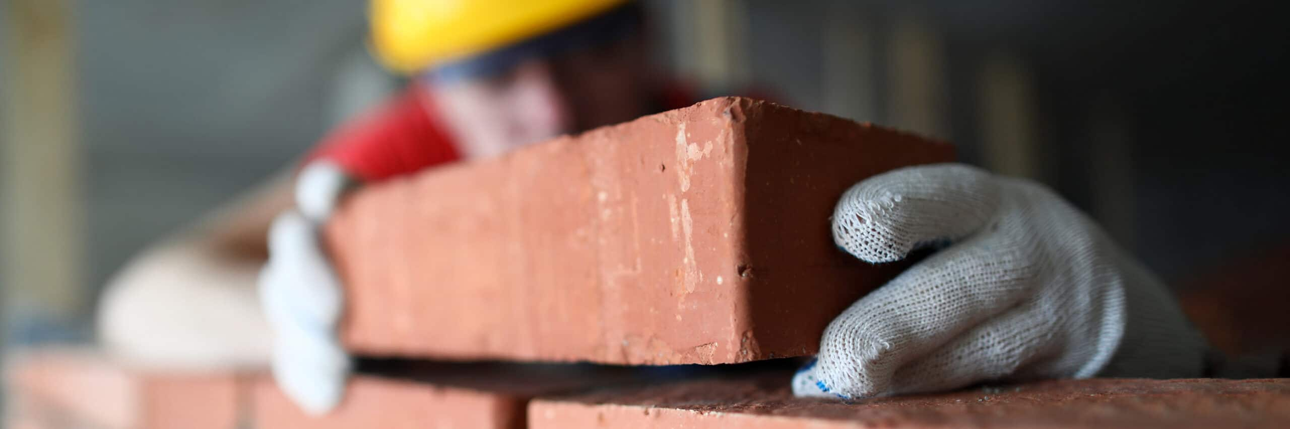 construction worker laying bricks